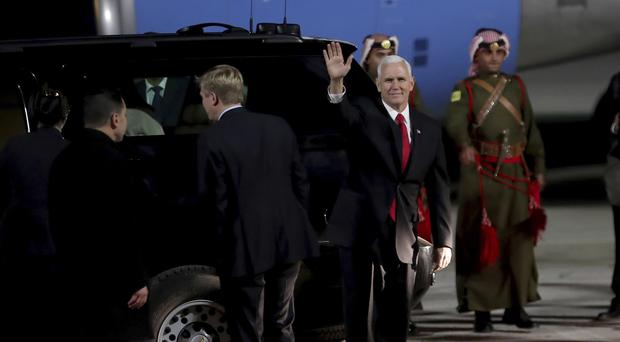 U.S. Vice President Mike Pence disembarks the plane upon his arrival at Amman military airport, Jordan. (Raad Adayleh/AP)