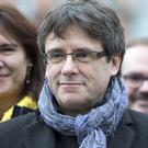 Carles Puigdemont fled to Belgium to avoid a court summons in Spain (Virginia Mayo/AP)