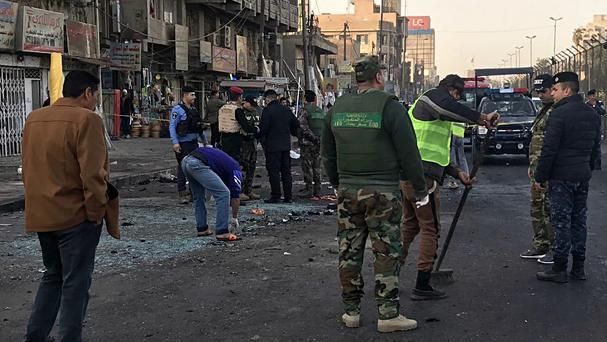 The aftermath of a suicide bombing in Baghdad earlier this month (Ali Abdul Hassan/AP)