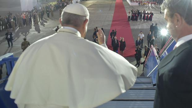 Pope Francis waving at the end of his South American trip (AP)
