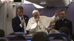Pope Francis speaking to journalists on his plane (Alessandra Tarantino/AP)