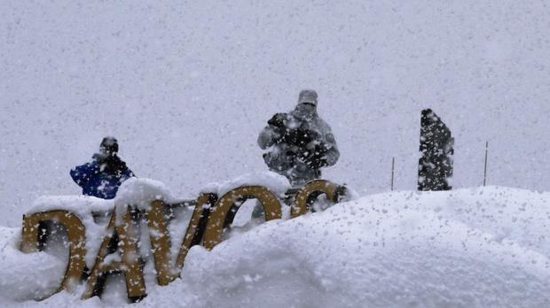 Armed police on a roof near the Davos conference venue (Markus Schreiber/AP)