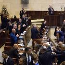 Protesting Arab politicians are thrown out during Mike Pence's address to Israel's Knesset (Ariel Schalit/AP)