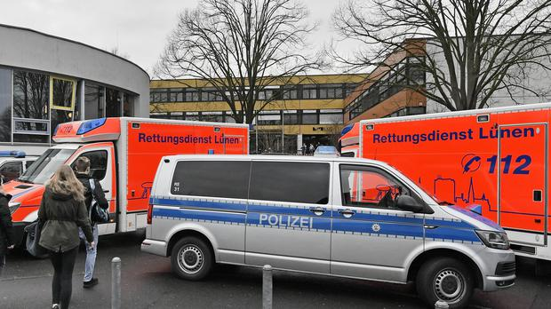 Emergency service vehicles outside the school (Martin Meissner/AP)