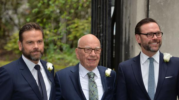 Rupert Murdoch with sons Lachlan (left) and James (right) (PA)