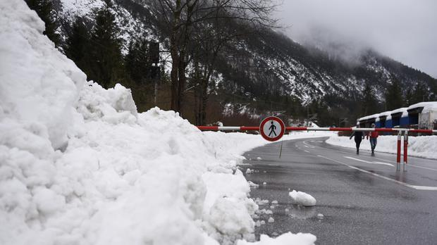 A road near the German-Austrian border is closed because of the risk of an avalanche (Angelika Warmuth/AP)