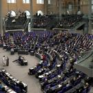 Politicians in the chamber of the Bundestag (Michael Sohn/AP)