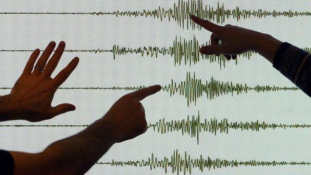 Seismologists point at a reading (David Cheskin/PA)