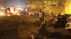 Debris at the site of one explosion in Benghazi (Al-Hadath Channel/AP)