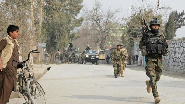Afghan security personnel patrol the site of a deadly suicide attack in Jalalabad (AP)