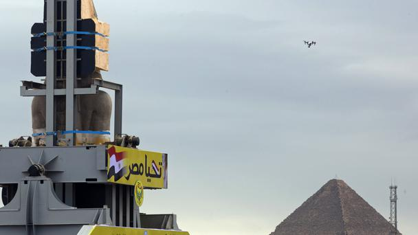 The colossal statue of Ramses on its journey to its new home (Amr Nabil/AP)