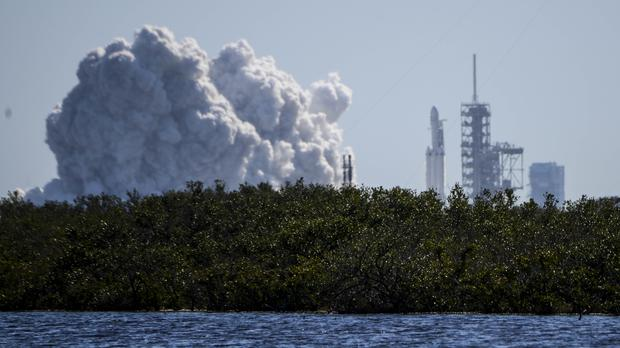 The Falcon Heavy briefly roared to life at Nasa's Kennedy Space Centre (Craig Bailey/Florida Today via AP)