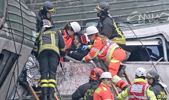 Right, a woman is pulled from the wreckage. Photo: AP