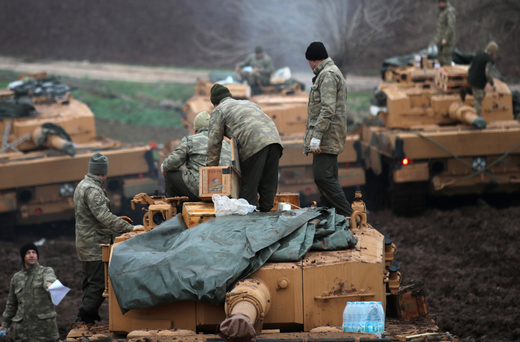 Turkish soldiers stand on their tanks near the Turkish-Syrian border in Hatay province, Turkey. Photo: Reuters