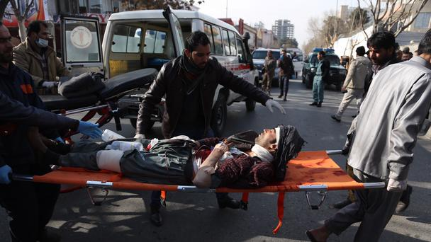 An injured man is moved to a stretcher outside a hospital following a suicide attack in Kabul (Rahmat Gul/AP)