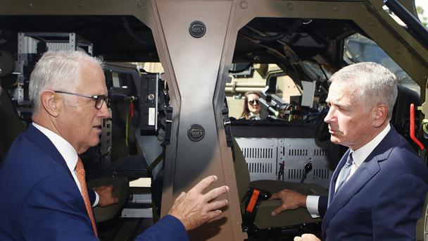 Australia Prime Minister Malcolm Turnbull, left, talks to Thales CEO Chris Jenkins (Daniel Munoz/AAP/AP)