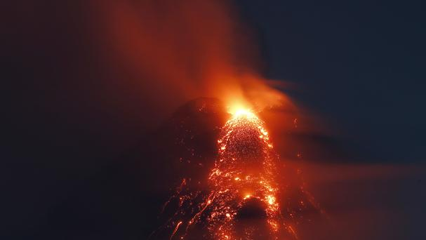 Molten lava flows down the slopes of Mayon volcano (AP)