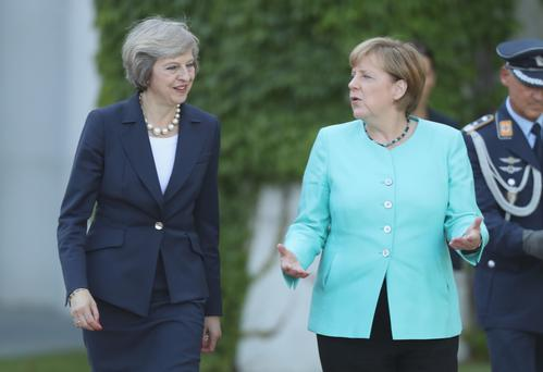German Chancellor Angela Merkel (right) with British Prime Minister Theresa May in Berlin in 2016. Ms Merkel mocked Mrs May's negotiating tactics on Brexit yesterday. Photo: Getty Images