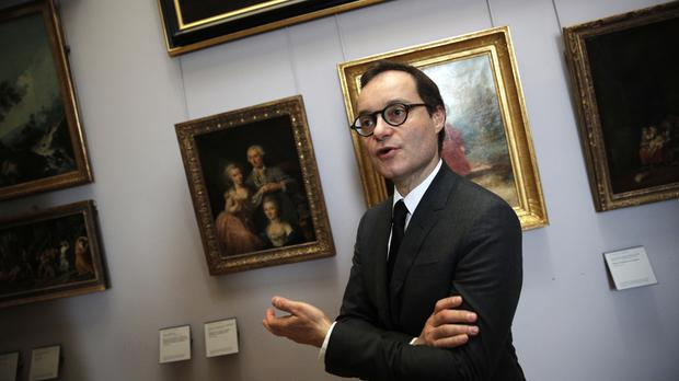 Head of paintings Sebastien Allard reveals some of the artworks on show (AP)
