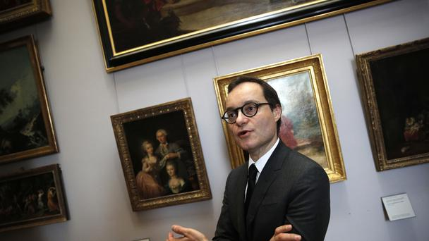 Head of paintings Sebastien Allard is trying to trace the rightful owners of the artworks (AP)