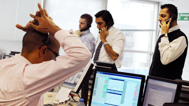 Equity markets were trading lower across the globe (Fiona Hanson/PA)