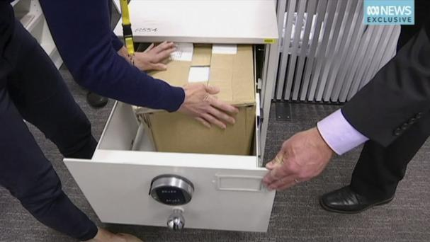 A documents box is placed in safe at the ABC bureau in Canberra (AP)