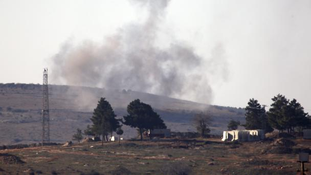 Smoke rises oin the air from Turkish forces shelling inside Syria, as seen from the outskirts of the town of Kilis, Turkey (AP)