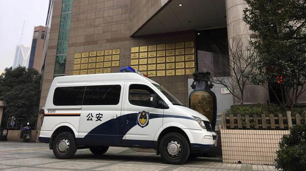 A police van sits outside the Changzheng Hospital where injured people were taken for treatment (AP Photo)