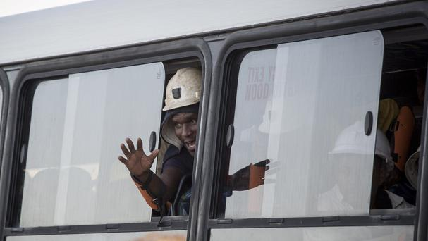 A bus carrying some of the more than 900 rescued miners transports them from the Sibanye-Stillwater's Beatrix mine near Welkom, South Africa (AP)