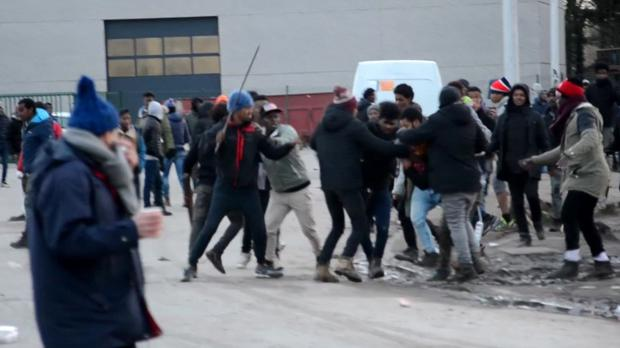 Migrants clash as fighting broke out in Calais (Nord Littoral via AP)