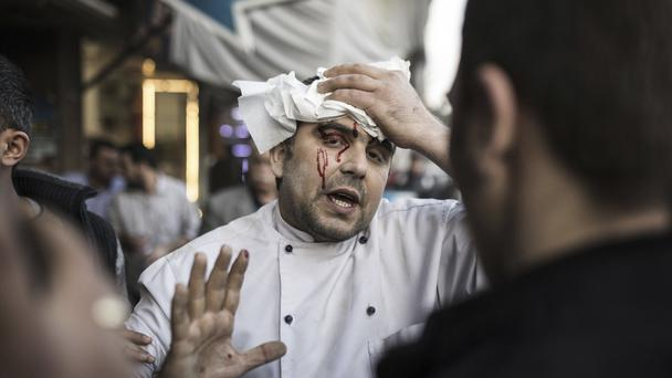 A restaurant worker was wounded in a rocket attack, fired from inside Syria (AP)