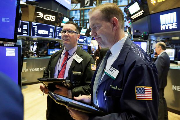 On Wall Street, the Dow Jones Industrial Average fell 291.39 points, or 1.11pc. Photo: Richard Drew/PA