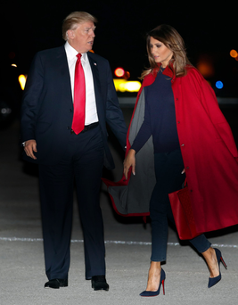 Donald Trump and first lady Melania Trump arrive on Air Force One at Palm Beach Airport on Friday. Photo: AP