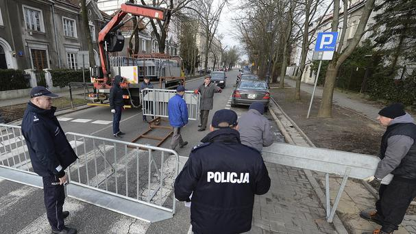 Workers put up barriers around the Israeli Embassy in Warsaw after a local governor banned traffic in the area to prevent a planned protest by far-right groups (AP Photo/Czarek Sokolowski)