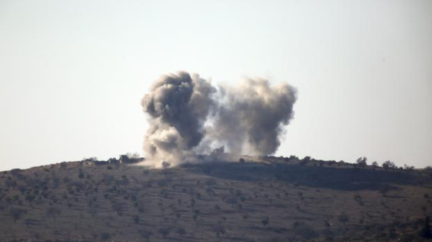 Smoke rises from shelling inside Syria (Lefteris Pitarakis/AP)