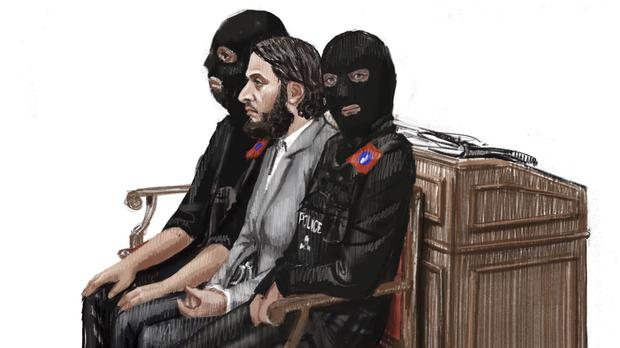 Salah Abdeslam is depicted sitting between two police officers during his trial at the Brussels Justice Palace (AP)