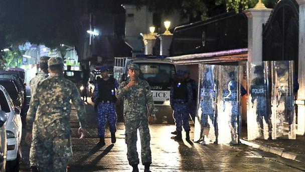 Maldives defence soldiers patrol on the main street of Male, Maldives. (Mohamed Sharuhaan/AP)
