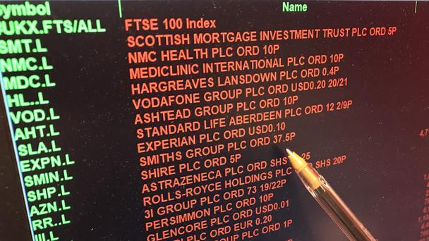 A screen showing the prices on the London Stock Exchange turns red as the FTSE 100 Index crashed on opening by more than 230 points to 7,104.94 as inflation fears continue to rock global markets.