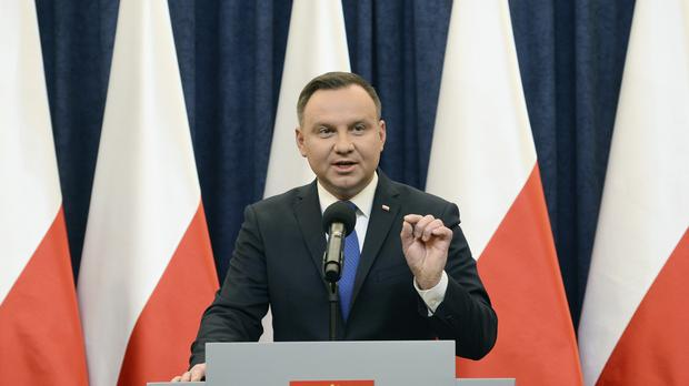 Polish president Andrzej Duda announces his decision to sign the bill into law (AP)