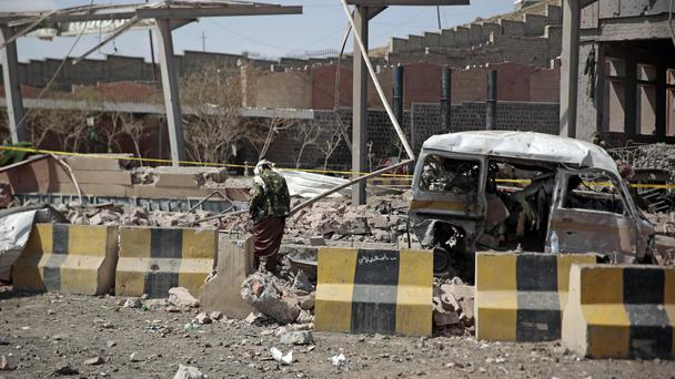 A man inspects rubble after a Saudi-led coalition airstrike in Sanaa, Yemen (AP)