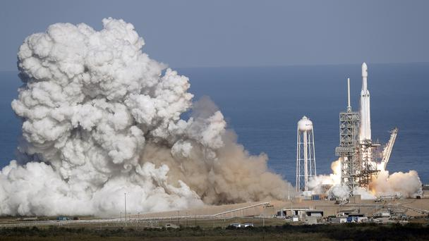 A Falcon 9 SpaceX heavy rocket lifts off from pad 39A at the Kennedy Space Centre in Cape Canaveral, Florida (John Raoux/AP)
