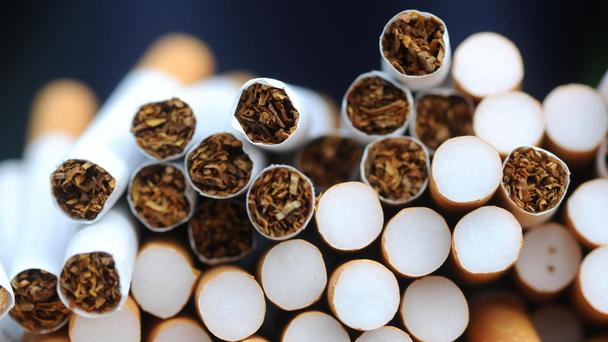 Imperial Brands said full-year earnings remain on track despite a first half hit from the collapse of Palmer and Harvey, the stronger pound and tighter regulation.