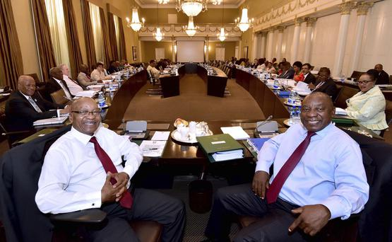 Jacob Zuma, and Cyril Ramaphosa, alongside government ministers (South African government/AP)