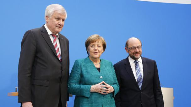 Angela Merkel, struck a deal with Martin Schulz, chairman of the Social Democratic Party,and Bavarian governor Horst Seehofer, chairman of the Christian Social Union (AP)