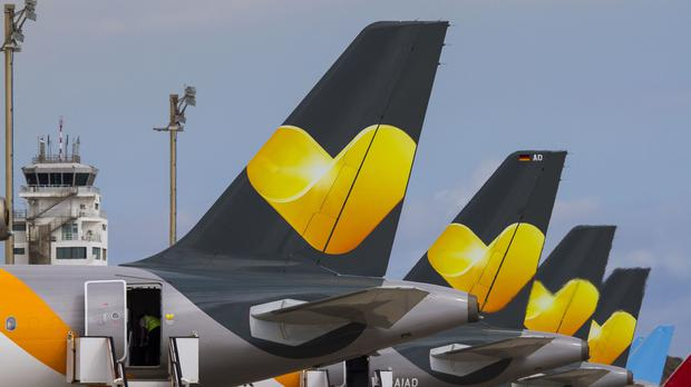 Thomas Cook has said demand for summer holidays abroad has showed no signs of slowing, but cautioned over an