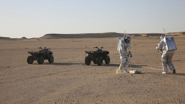 Two scientists test space suits and a geo-radar for use in a future Mars mission in the Dhofar desert of southern Oman (Sam McNeil/AP)