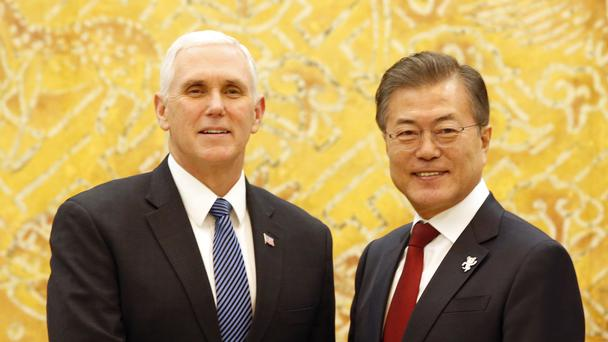 US vice president Mike Pence shakes hands with South Korean President Moon Jae-in (AP)