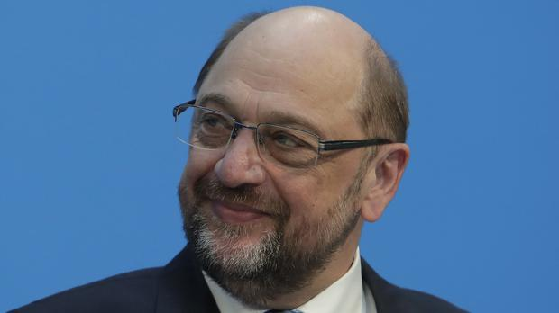 Mr Schulz said he hoped his announcement would end turbulence within the party (AP)