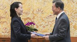 South Korean President Moon Jae-in receives a letter from Kim Yo Jong, North Korean leader Kim Jong Un's sister, at the presidential house in Seoul (Kim Ju-sung/Yonhap via AP)