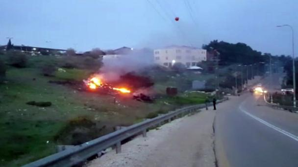 In an image made from video, the wreckage of a jet is seen on fire near Harduf, northern Israel (Yehunda Pinto via AP)